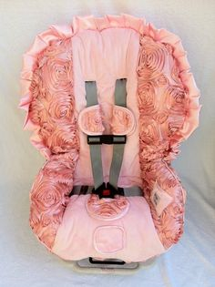 Cute car seat cover! This way you can get an ugly, cheaper carseat and make it genderly acceptable!