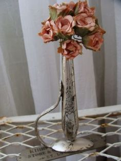 """A cute little """"bud vase"""" made from a hollow knife handle and a bent spoon to give it a base to stand on- No tutorial but you can still-DIY"""