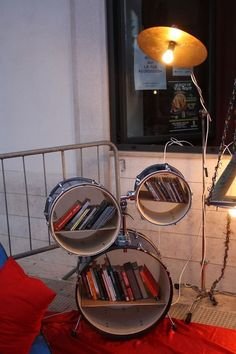 old drum kit turned into a bookshelf