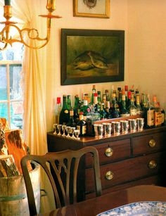 Simple yet comprehensive home bar set up on an antique dresser with elegant silver drinkware #home #decor