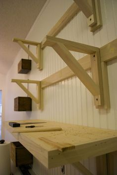 make a jig for shelf brackets. Garage for lumber.