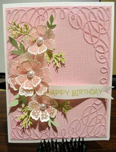 3/26/2012; Trudi Wilblur; Vellum flowers | Flickr - Photo Sharing!  Trudi stamped the flowers with Versa Mark and embossed with white powder.  Lovely flower stamp, and nice use of this EF as the frame