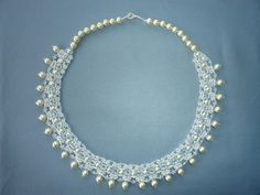 DIY Jewelry: FREE beading pattern for a lacy vintage pearl necklace made from twin (two-hole) beads, pearls, and seed beads. Very lovely!