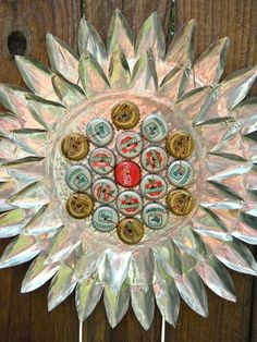 Bottle cap / tin pie plate flower... could also do this with clear glass plates and glass gems (flat-back)...