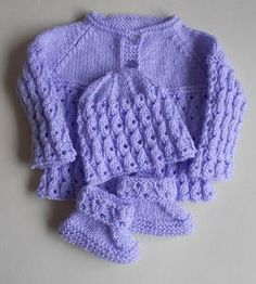 Lilac Blossom Baby Set - Want to make the perfect baby shower gift? This Lilac Blossom Baby Set will make any new mom giddy with excitement. The adorable free knitting patterns for babies included in this set are for a sweater, knit hat, and knit baby booties, keeping your baby in style from head to toe. Light and airy while still being cozy, any baby will look as cute as can be in this precious ensemble.