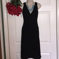 "Jones New York Black Dress Gorgeous black sparkle  V neckline dress. 40"" lenght from shoulder strap to bottom bust 34""& 29"" waist. Made of 100% polyester. ( Please ask before buying sale is FINAL / NO RETURN) Jones New York Dresses Midi"