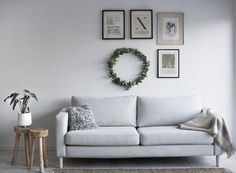 As part of our sustainability project we enlisted the help of Emma Elwin from Make it  Last to update an old IKEA Karlstad sofa with a Bemz cover in Silver Grey Brunna Melange made from 100% recycled materials | simple grey nordic scandinavian interior | grey sofa with a rustic sideboard | simple wall gallery