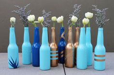 Super cool painted bottles - to get texture, first create designs with glue or bubble paint, let dry, then paint