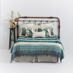 A coverlet in peaceful shades of blue makes a serene addition to the bedroom.