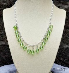Love this green german glass from the 1940's!! Wire wrapped on non tarnish wire in a cascading p