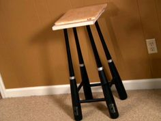 DIY: baseball bat table...Good present for the guys :) just find old bats obviously