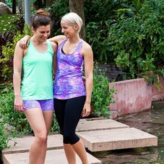"""There are so many beautiful reasons to be happy... ☺️ @clarejbyoga wears the Contrast Twist Tank and the Flowering Lotus Short Tight. @daniquerambo wears…"""
