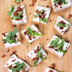 Cream cheese, bacon and arugula on flatbread? THIS is what we call a flavor-packed party snack!