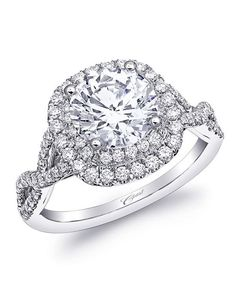 Coast Diamond engagement ring with cushion-shaped double halo of diamonds in white gold I Style: LC10029 I Charisma Collection I https://www.theknot.com/fashion/charisma-collection-lc10029-coast-diamond-engagement-ring?utm_source=pinterest.com&utm_medium=social&utm_content=june2016&utm_campaign=beauty-fashion&utm_simplereach=?sr_share=pinterest
