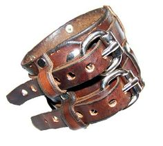 Wide Double Belted Leather Wrist Cuff. $33.36, via Etsy.
