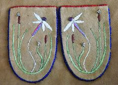 """Moccasin vamps created for the Walking With Our Sisters exhibit honoring and commemorating the hundreds of missing and murdered Canadian Indigenous women representing their """"unfinished lives"""" This image is from Native People's Magazine Sept. Peyote Patterns, Beading Patterns, Beading Ideas, Dragonfly Wall Art, Beaded Moccasins, Nativity Crafts, Textiles, Native Beadwork, Art Textile"""