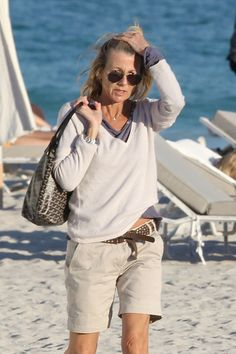 French journalist Claire Chazal and her boyfriend Arnaud Lemaire spend another day at the beach while vacationing in South Beach. Chazal spent the afternoon reading and napping on a comfy lounge chair while Lemaire jet-skied in the ocean. Arnaud Lemaire riding Jetski.