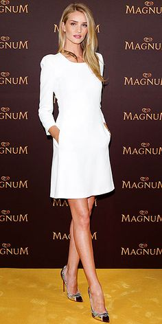 ROSIE HUNTINGTON-WHITELEY Now that's how you make white look hot! Rosie accessorizes her simple sheath with a sexy Giusepe Zanotti Design collar necklace and metallic platform stilettos at the premiere of her new Magnum ad in Berlin.
