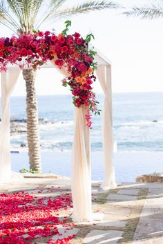 beach wedding | colorful floral arbor | in tandem photography | via: style me pretty