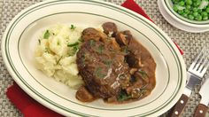 Comfort foods are never out of style and are often craved the most. You can adapt this favourite for vegetarians by using soy burgers and vegetable stock in the gravy. Serve with mashed potatoes and peas. Salisbury Steak With Mushroom Gravy Recipe, Salisbury Steak Recipes, Entree Recipes, Pork Recipes, Cooking Recipes, Barbecue Recipes, Veggie Patties, Dinner Entrees, Recipes