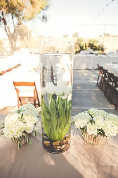 Unique centerpieces /// Photo by Lindsey Gomes Photography, Florals by Kristin Jaureguy via Project Wedding