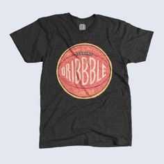 Dribbble's here this month with a big assist from teammate Jon Contino. A throwback basketball—betcha didn't know basketballs used to have laces—soft-hand printed in vintage pink, orange, and cream on a Tri-Black American Apparel tri-blend track tee.- http://www.unitedpixelworkers.com/products/dribbble