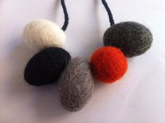 Felt Ball Necklace - Orange,White, Black, Grey. $20.00, via Etsy.