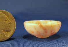 "Jeff Spera - turned Utah raspberry rippel alabaster  stone bowl Standing just 1/2"" tall and 1"" in diameter."
