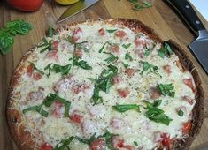 flourless pizza crust. dukanitout add your regular favorites on this crust. I use Italian turkey sausage, cheese, mushrooms, greenpeppers,....