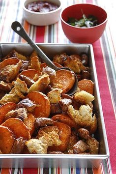 Baked spicy sausages with sweet potato.