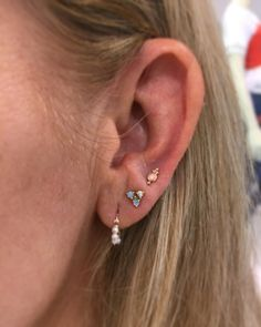 """Doesn't need to be matchy-matchy. Pretty trio.   69 Likes, 2 Comments - Kevin (@kevinthepiercer) on Instagram: """"First piercing at the @maria_tash @hudsonsbay pop up! Third lobe pierced with our opal four ball…"""""""