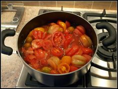 A mixed batch of tomatoes being made into sauce
