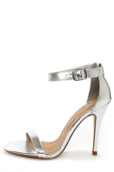 Check it out from Lulus.com! Your new dancing shoes are ready and waiting for a spin on the dance-floor! The My Delicious Chacha Silver Metallic Single Strap High Heels keep it simple with a thin silver toe strap in metallic vegan leather, paired with a sleek heel cup and ankle strap that adjusts with a silver buckle (and hidden elastic). Strut your stuff in a 4.5