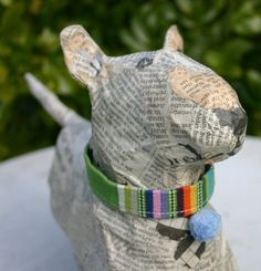 Large Papier Maché Bull Terrier with Green Striped Collar and Bobble