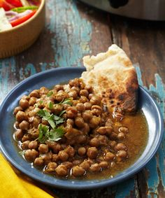 This version of chana masala, a dish of chickpeas braised in a gingery tomato gravy, is for those of you who love having a deeply seasoned sauce to sop up with naan or ladle over rice. It's for you if you crave big flavor from a vegetarian dish, and this recipe is especially for you if you're looking for a slow-cooker recipe that's going to take you past the eight-hour mark into 10-hour territory.