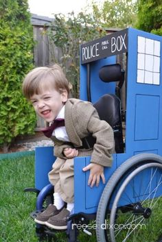 """FTA: """"Atti, the son of Reese Dixon, moves through time and space in his own TARDIS while dressed as the Eleventh Doctor. Finding a tweed jacket proved nigh impossible, so she cut an adult one down to size and added a stylish bowtie but, sadly, no fez."""" Now THAT'S a wheelchair costume! (via Oddee)"""