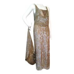 1920s Incredible French Sequined Evening Gown w/ Train Imported by Harry Angelo | From a collection of rare vintage evening dresses at https://www.1stdibs.com/fashion/clothing/evening-dresses/