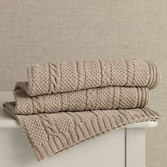 Must-have baby blanket in an exquisitely textural, pure cotton, cable-knit design.