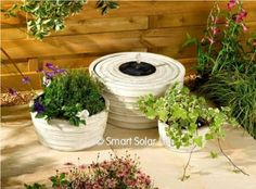 Small Solar Ed Water Feature In Antique White Effect Fountain And Matching Planter Set