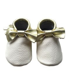 Look what I found on #zulily! Cream & Gold Bow Leather Booties #zulilyfinds