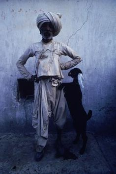 Cary Wolinsky    Mota Varnora, Kutch, India. Portrait of Hera Rama, a farmer/shepherd from the village Mota Varnora in Kutch, India, with a goat kid. He is wearing a traditional cotton costume of the Robari people.