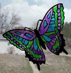 Butterfly Sun Catchers  made using transparency film and sun catcher paint.