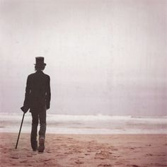 Guy wearing a top hat walking to sea. Story Inspiration, Writing Inspiration, Character Inspiration, Dreams And Nightmares, Howls Moving Castle, Famous Photographers, Before Us, Victorian Gothic, Jojo's Bizarre Adventure
