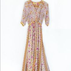 Spell & the Gypsy Boho Blossom Maxi Dress S Rare Spell & the Gypsy Boho Blossom Maxi Dress  Sold out everywhere!  Gorgeous! NWT.  This summer, it's you, the open road, and the perfect maxi. The Boho Blossom Dress is orange, yellow and beige, and features vintage-inspired floral prints, front button closure, and 3/4 length sleeves. Side slits, unlined. We love it with vintage boots and a distressed denim jacket, or gladiators and a flower crown. By Spell.  *Rayon  *Runs true to size  *Model…