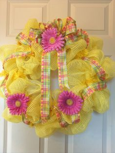 A pastel look for Spring into Summer . .Yellow wide thread mesh, pastel ribbon and bow and 3 Gerbera daisies!