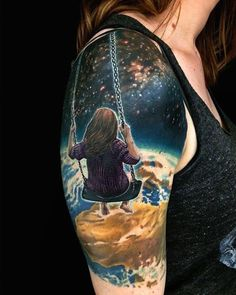 This tattoo shows a girl in a swing looking down at earth from the universe. Surreal but beautiful. Plus the story behind it could depend on what you think.