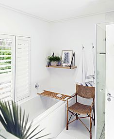 High on the mountainside overlooking Plettenberg Bay lagoon, Indigo House commands a spectacular view and boasts signature indigo, white and wood interiors. Wood Interiors, Rental Property, Clawfoot Bathtub, South Africa, Indigo, Pools, Bathrooms, House, Vacation