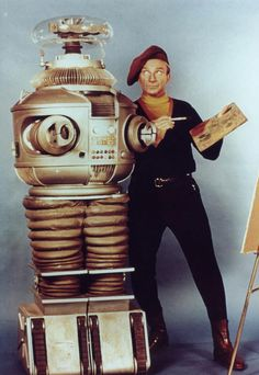 Lost in Space: The Robot and Dr. Smith. I watched the re-runs as a kid :)