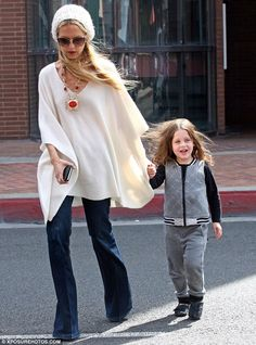New look: Rachel Zoe wore a white beanie hat as she picked up her son Skyler from school i...