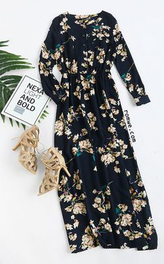 Navy Long Sleeve Floral Maxi Dress  Color: Navy Dresses Length: Maxi Style: Party Material: Cotton Blends Neckline: Round Neck Silhouette: Shift Pattern Type: Floral